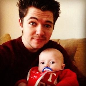 Damian holding his nephew Noah
