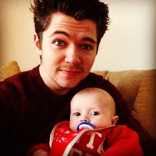 Damian McGinty wallpaper possibly containing a milk called Damian holding his nephew Noah
