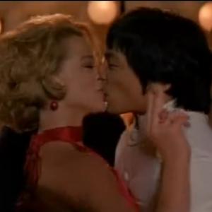 Linda kisses Bruce