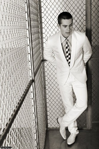Dylan O'Brien wallpaper with a chainlink fence and a business suit titled Dylan O'Brien
