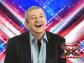 Louis Walsh laughing on X Factor