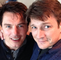 Nathan and a friend - nathan-fillion-and-stana-katic photo