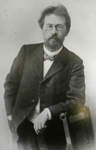 Poets & Writers wallpaper with a business suit, a suit, and a dress suit titled Anton Chekhov