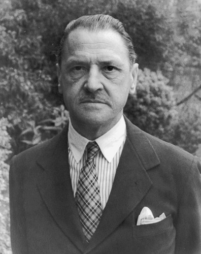 Poets & Writers wallpaper with a business suit, a suit, and a double breasted suit titled W. Somerset Maugham