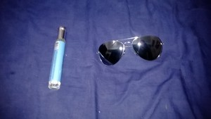 my new sunglasses and my new perfum