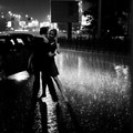 dancing in the rain couple - travel photo