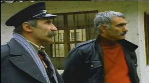 Турецкое кино Обои possibly with a business suit and a penal institution entitled tuncel kurtiz and yılmaz güney