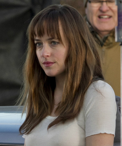 Fifty Shades of Grey wallpaper probably containing a portrait entitled Dakota on the set of Fifty Shades of Grey