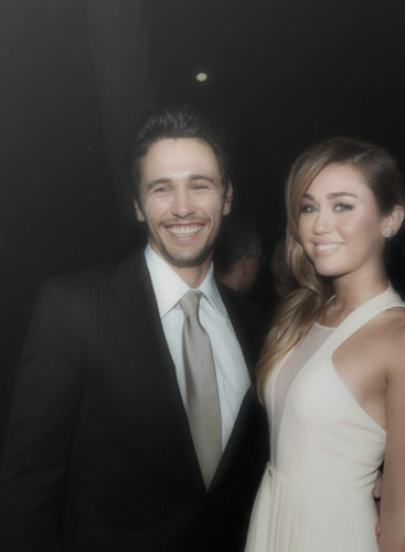 James Franco karatasi la kupamba ukuta with a business suit, a suit, and a two piece titled james franco and miley cyrus
