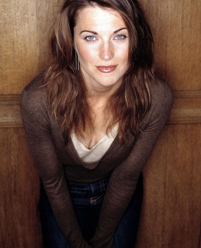Lucy Lawless wallpaper probably with a well dressed person, an outerwear, and a blouse entitled Lucy Lawless