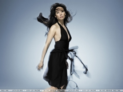 Lucy Liu wallpaper probably containing a cocktail dress entitled Lucy Liu Photoshoot