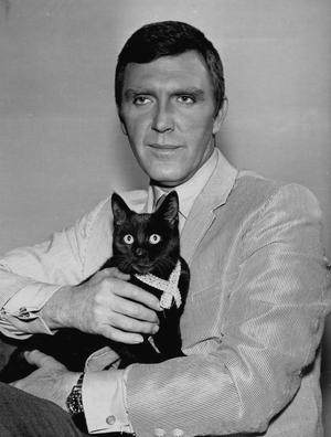 Robert Lansing Holding A Cat