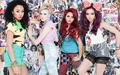 Little Mix posing onto comix uithangbord