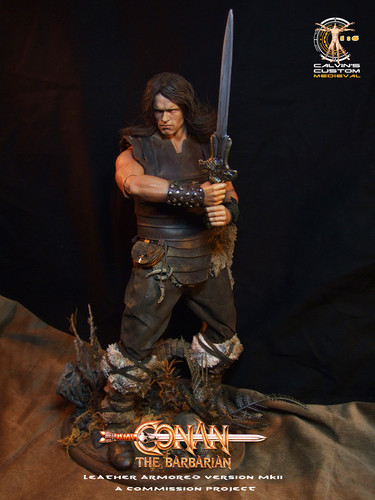 Arnold Schwarzenegger Hintergrund possibly containing a sign called Calvin's custom one sixth scale Conan figure