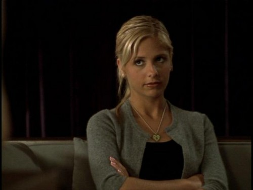 Buffy Summers wallpaper probably with a portrait titled Buffy Summers Screencaps