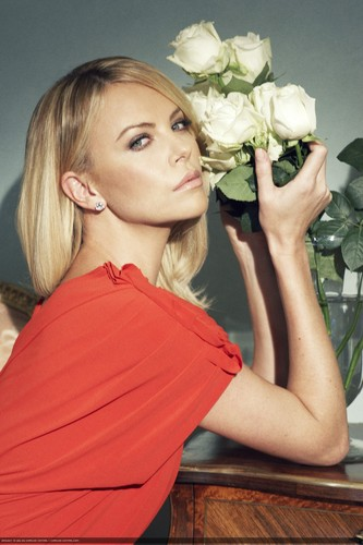 Charlize Theron wallpaper containing a popcorn, a red cabbage, and a popcorn titled * charlize *