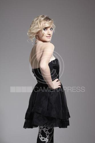 Evanna Lynch wallpaper probably containing a cocktail dress and a gathered skirt called Evanna by Tessa Hallmann