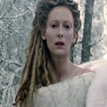 Jadis looks down at Edmund on the snow
