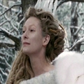 Jadis waits for Edmund to sit beside her - jadis-queen-of-narnia photo