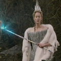 Jadis with her wand in her left hand turning the butterfly to stone,