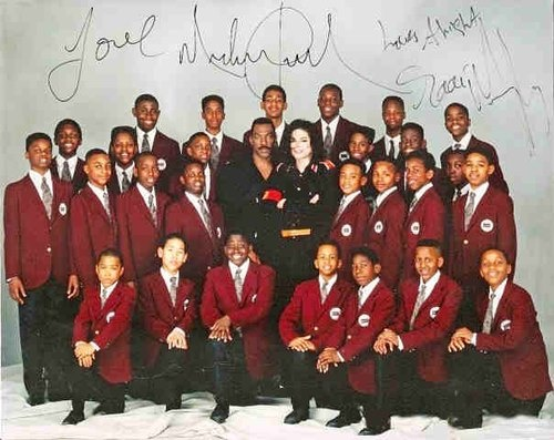 An Autographed Picture Of Michael With Eddie Murphy And The Boys Choir Of Harlem