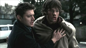 Dean helping Sam