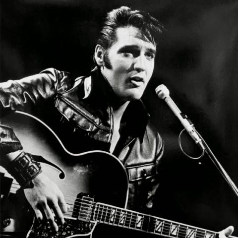 Elvis Presley wallpaper with a guitarist entitled '68 Comeback Special