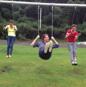 "John Green swinging with ""Hazel"" and ""Augustus"" from the movie The Fault in our Stars"