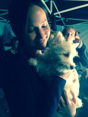 Josh Hutcherson and Jennifer Lawrence on set with a dog
