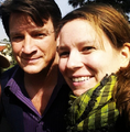 Nathan and some fan-BTS 6x20 - nathan-fillion-and-stana-katic photo
