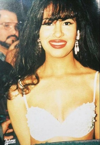 Selena Quintanilla-Pérez wallpaper possibly with attractiveness, a brassiere, and a portrait titled Queen of Tejano ♥
