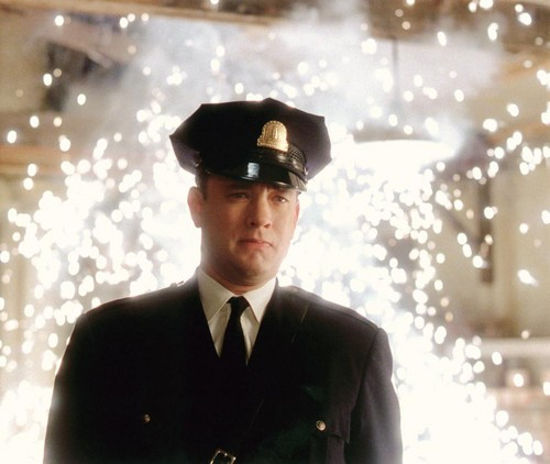 Tom Hanks achtergrond probably containing uniform, regimentals, dress blues, and a green beret, baret entitled The Green Mile