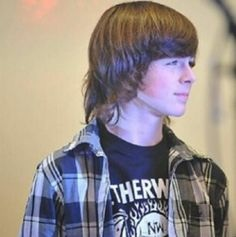 Chandler Riggs Hintergrund possibly with a portrait entitled Chandler Riggs