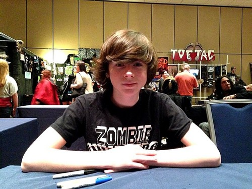 Chandler Riggs wallpaper possibly with a Leggere room and a sign entitled Chandler :)