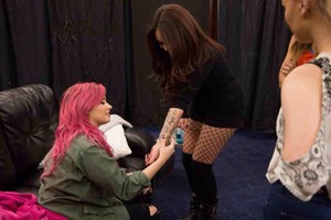 Demi checkin out Jesy's tojo - backstage at the Neon Lights Tour