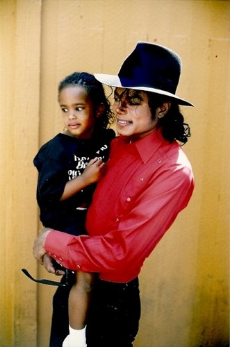 Michael holding a child