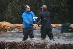 Royal Princes Help Build Flood Defenses