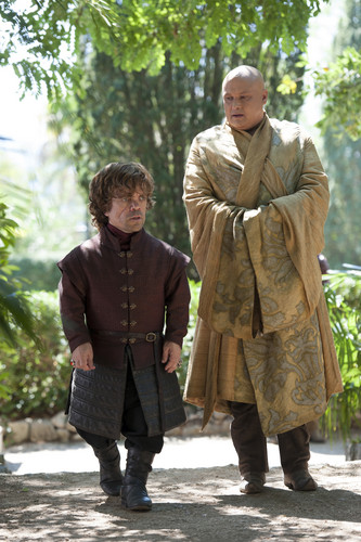 House Lannister wallpaper possibly containing a box coat, a green beret, and an outerwear titled tyrion and varys
