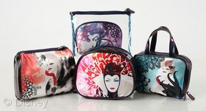 An Assortment Of Handbags And Makeup Pouches