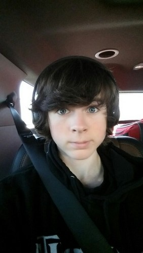 Chandler Riggs Hintergrund probably containing an automobile called Chandler :)
