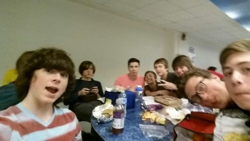 Chandler Riggs Hintergrund probably containing a portrait entitled Chandler with his Friends at lunch