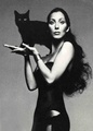 Cher Holding A Black Cat - cats photo