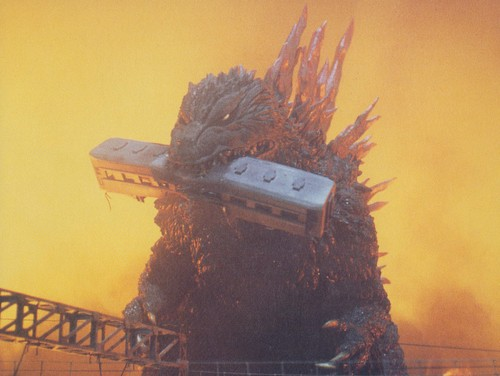 Godzilla wallpaper entitled Godzilla Eating A Train