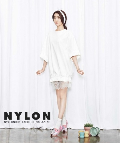 Sunmi Обои probably containing a bathrobe, a well dressed person, and a nightwear titled Sunmi 'Nylon'
