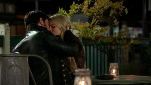 Captain Hook and Emma Swan wallpaper possibly with a street and a lectern titled CaptainSwan3x22Kiss@