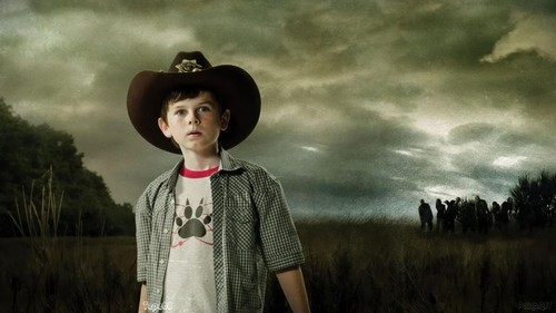 Chandler Riggs Hintergrund containing a fedora, a boater, and a snap brim hat titled Carl Grimes