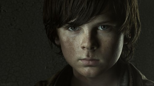 Chandler Riggs Hintergrund possibly containing a portrait titled Carl Grimes