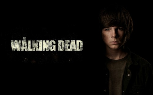Chandler Riggs Hintergrund possibly with a sign entitled Carl Grimes