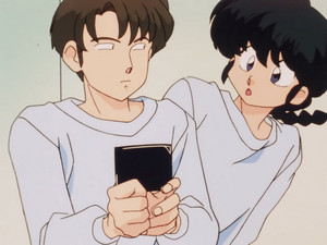 Ranma catches Daisuke with a picture of his fiance (Akane)