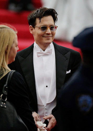 Johnny Depp wallpaper containing a business suit, a suit, and a dress suit entitled The MET Gala 2014